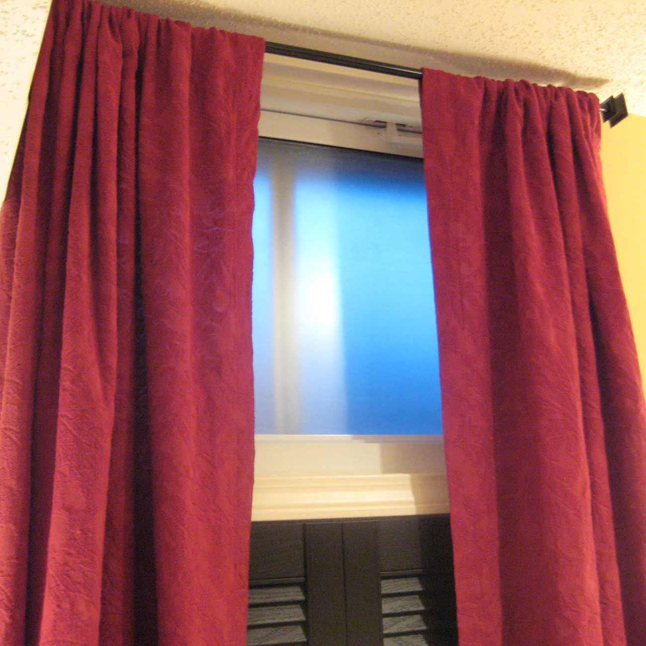 basement window curtains in rose red