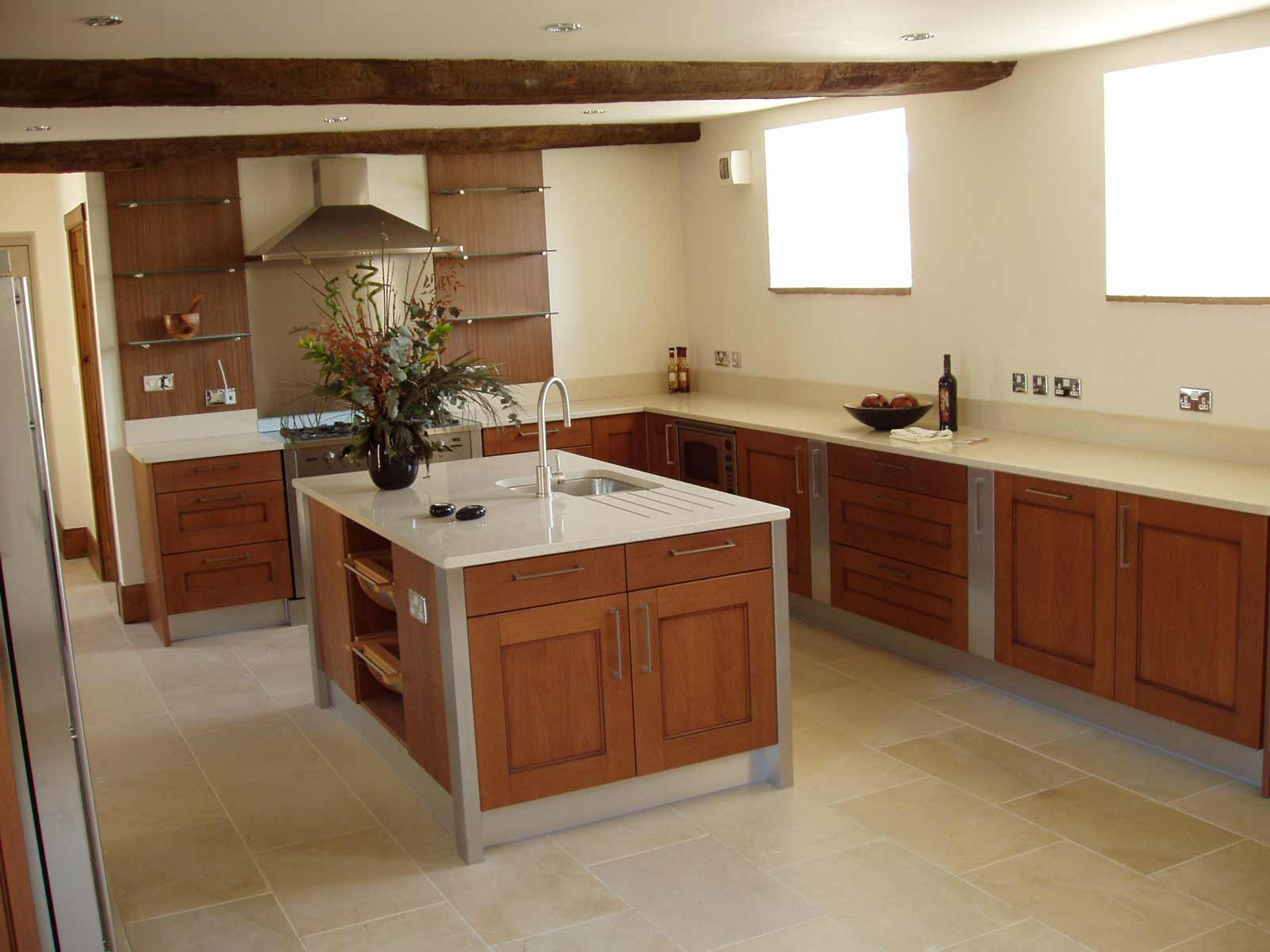 Laminate flooring kitchen feel the home for Best kitchen tiles design