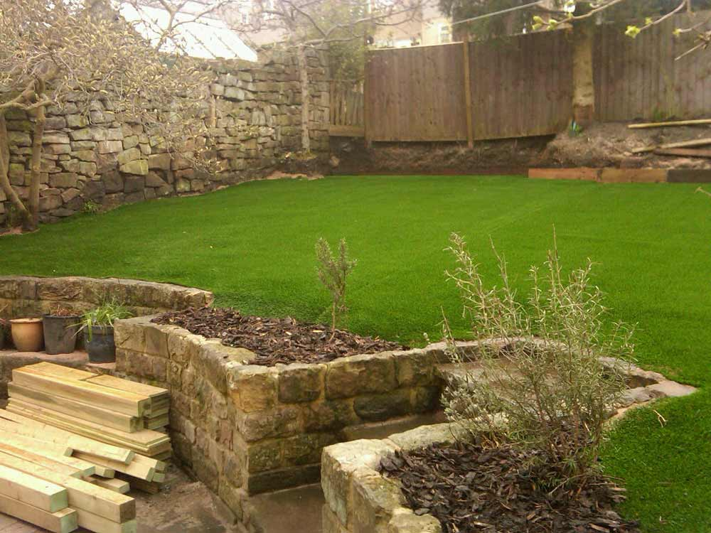 natural lawn with artificial grass carpet