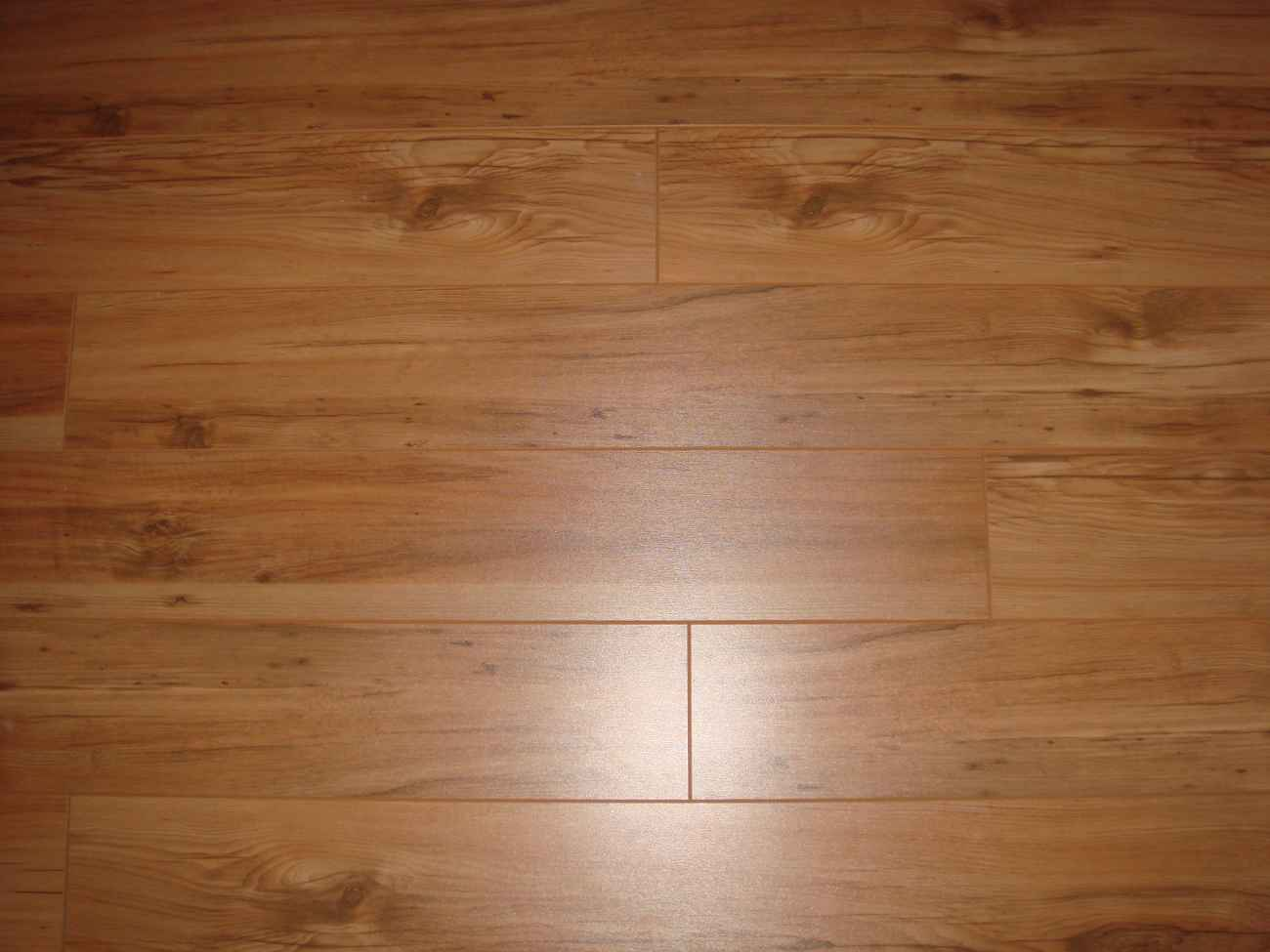 Faux wood ceramic tile feel the home for Fake wood flooring