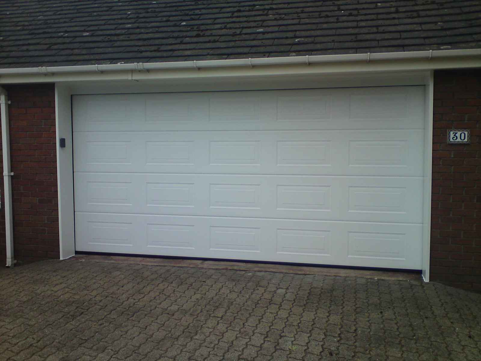 Cheapest garage doors ideas for Garage door opens on its own