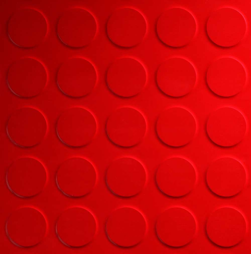 circle motif ceramic floor tiles in red