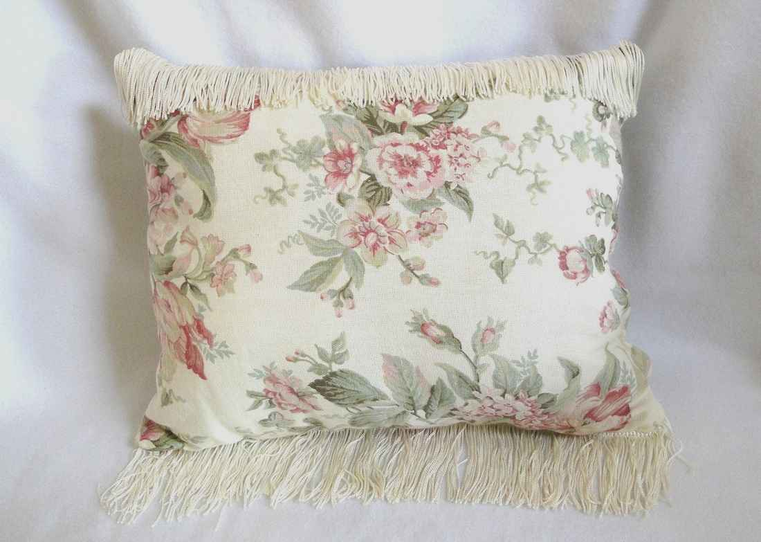 sofas throw pillows in flower motif