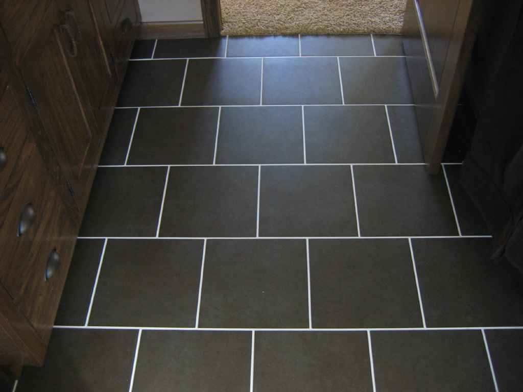 Brick kitchen flooring feel the home for Black floor tiles for kitchen