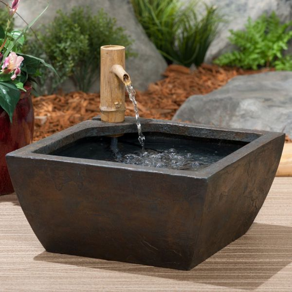 Three astonishing garden water features ideas you should have for Bamboo water garden