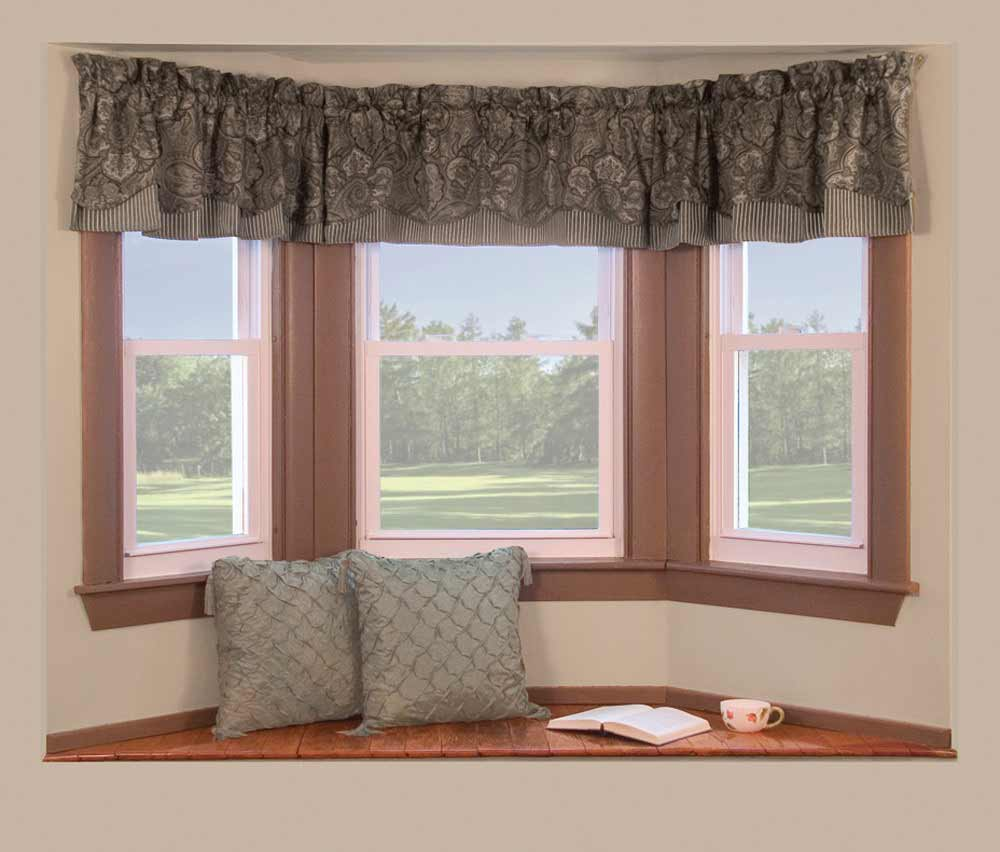 Pale bay window with curtains and pillow