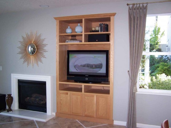 Wooden built in TV cabinets and bookscase