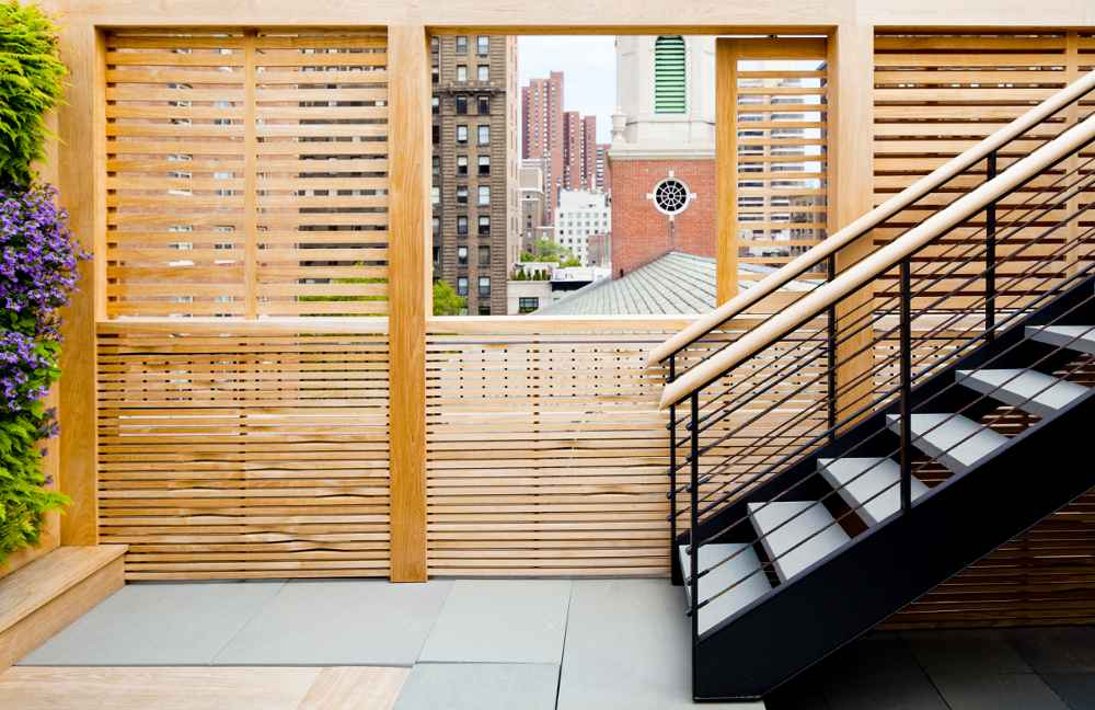 Teak sliding wall panels for outdoor use